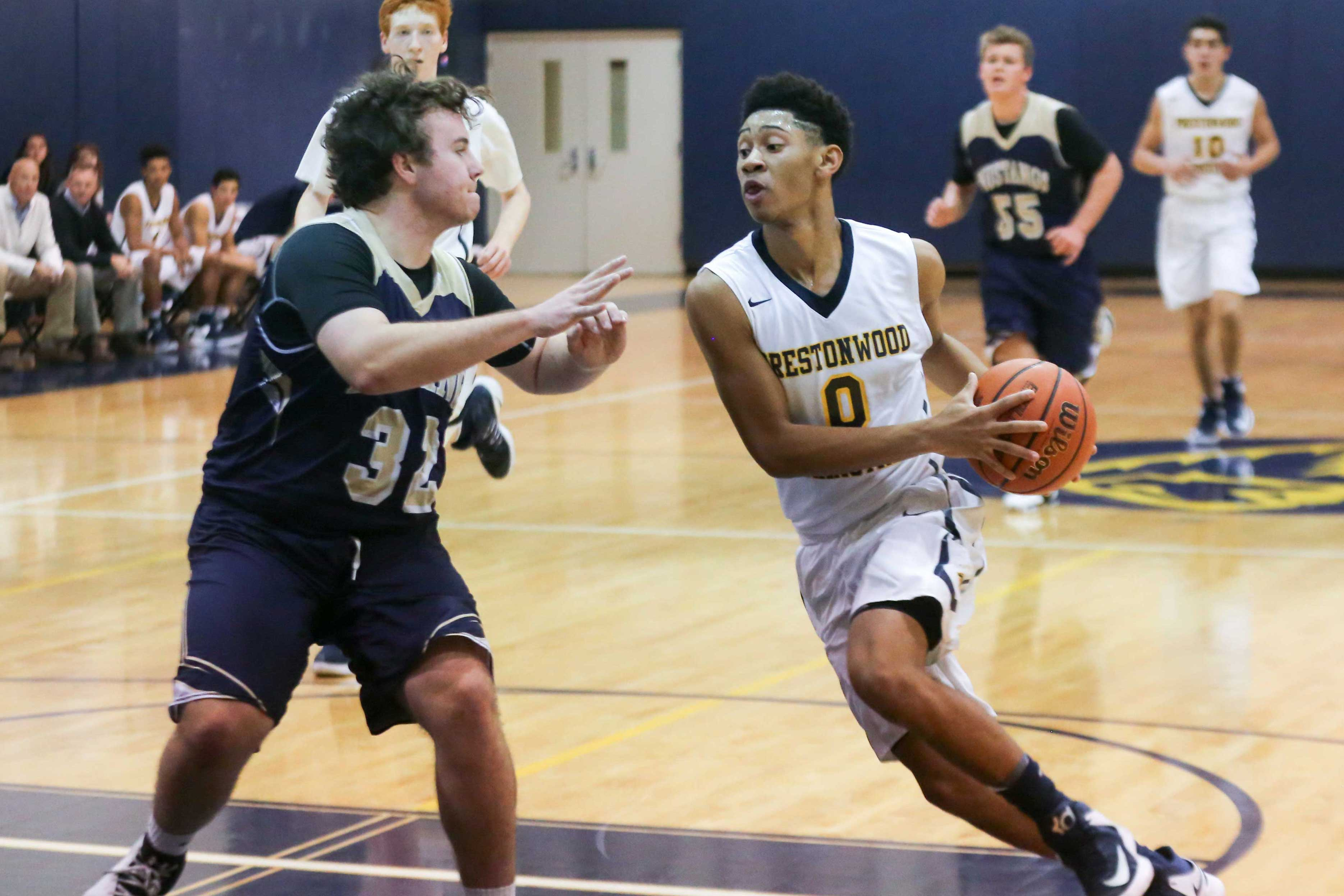 Sophomore Justin Webster drives for the basket against McKinney Christian. This is Justin's second year as a starter on the Boys Varsity Basketball team.