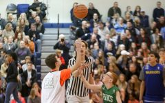 Referee Senior Dylan Claassen gets the game started with the jump ball.