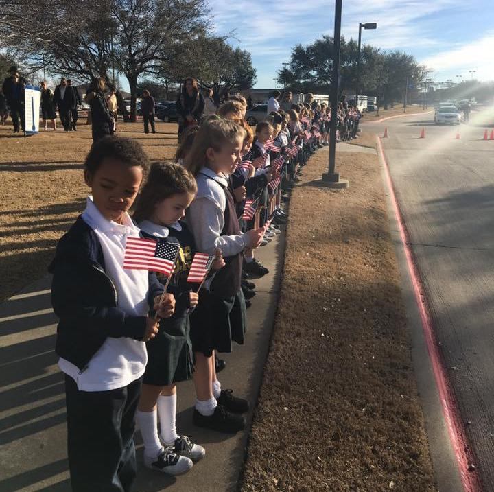 Students from First grade teacher Laura Mitchell's class line the sidewalk in honor of fallen Little Elm Police Officer, Detective Jerry Walker.