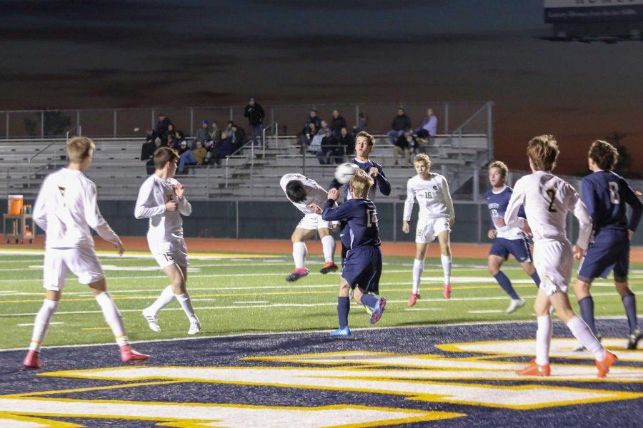 Senior Alex Song battles for a goal against Liberty Christian. The Lions defeated the Warriors, 1-0.