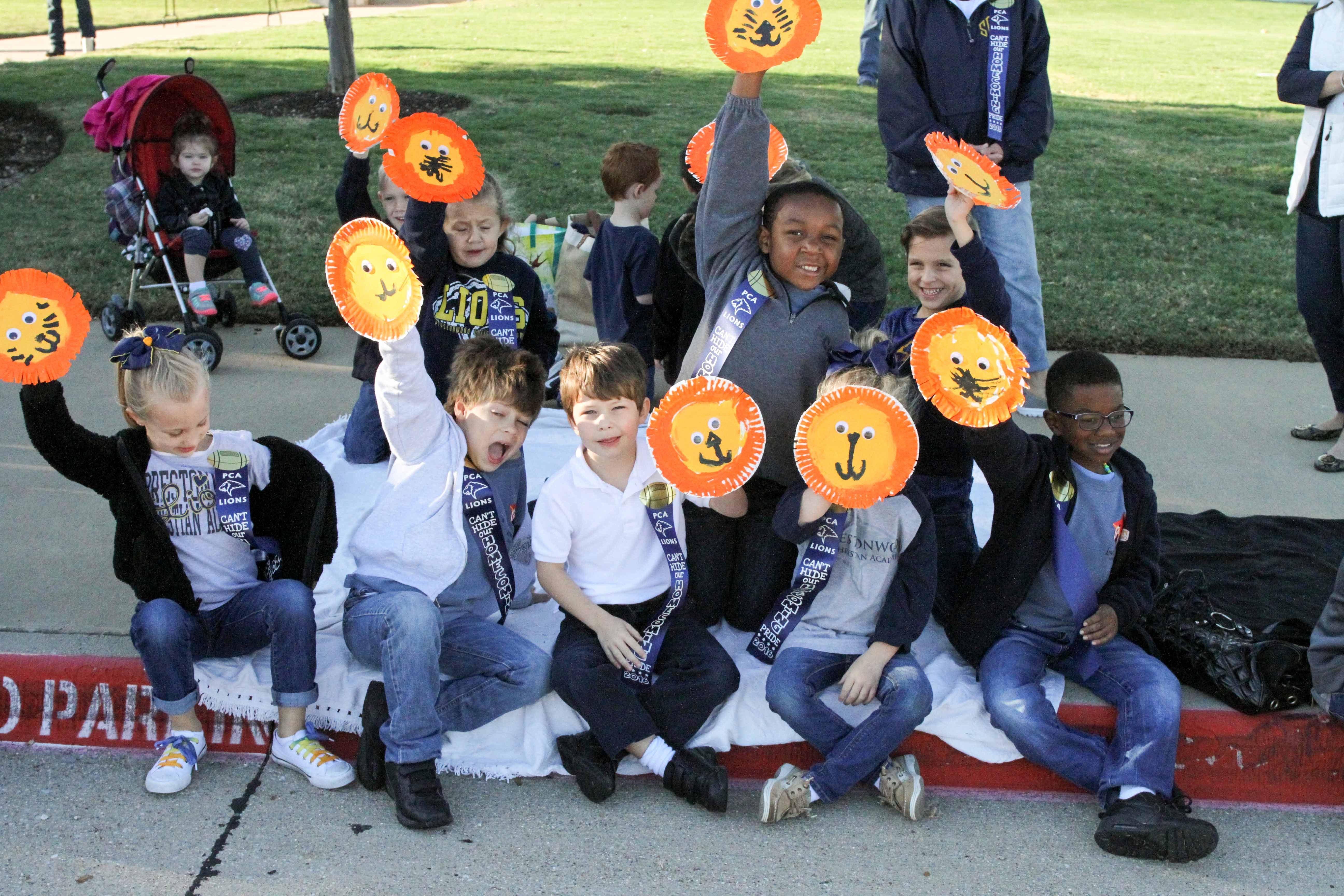 Students from Kindergarten teacher Julie Zarzycki's class at the North Campus wave lion shakers as the Parade passes by.