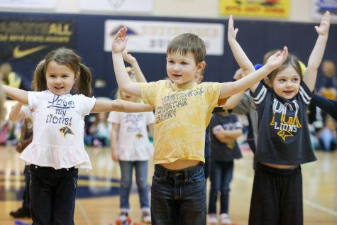 Pre-K 4 students Shaylin Nolan, Case Callander and Lucy Henrie get moving during the P.E. Showcase.