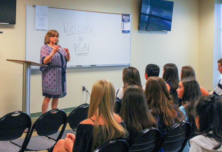 Upper School Principal Mrs. Wendy Morris welcomes new students during Back to School Day.