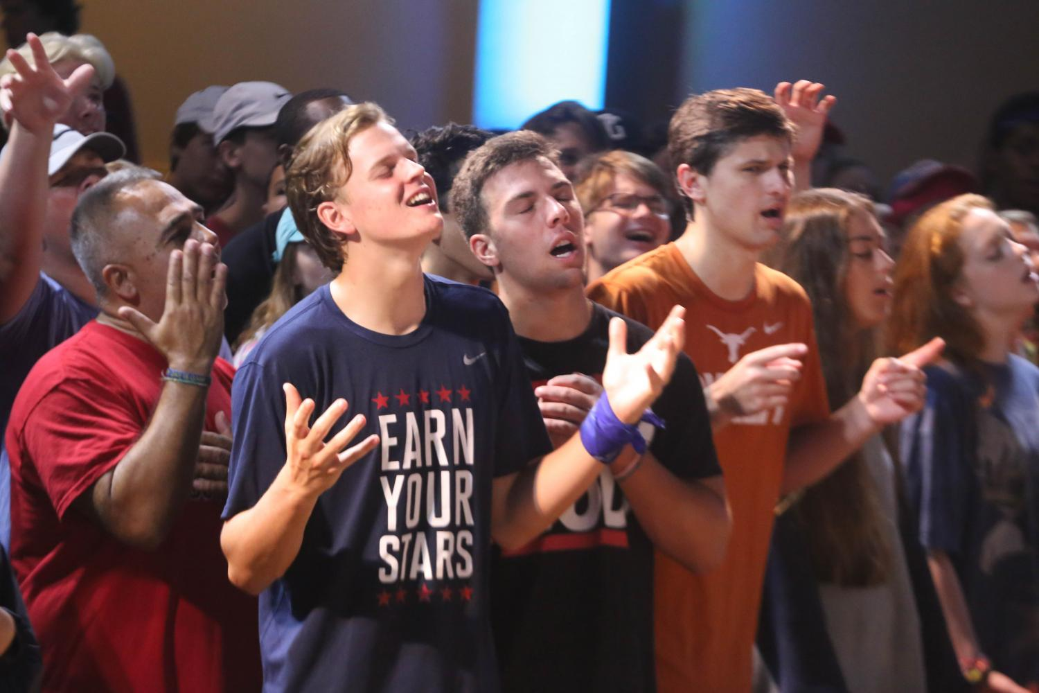 Spanish teacher Mr. Jody Garcia and Seniors Wiley Green, Sam Boese and Preston Panetti  worship with the JWood Band to focus their hearts and minds before Pastor Rob Wilton's message from Ephesians. He urged students to be ready before the battles come by utilizing the whole armor of God.