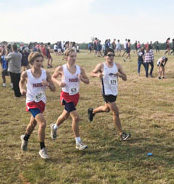 Senior Evan Reyna races the course at the District Cross Country meet near Joe Pool Lake.