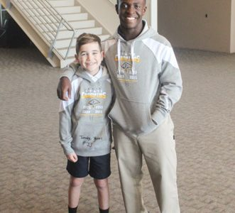 Fourth grade student Wyatt Neale wears the autographed State Championship hoodie given to him by his favorite Varsity Football player, Tim Taylor.