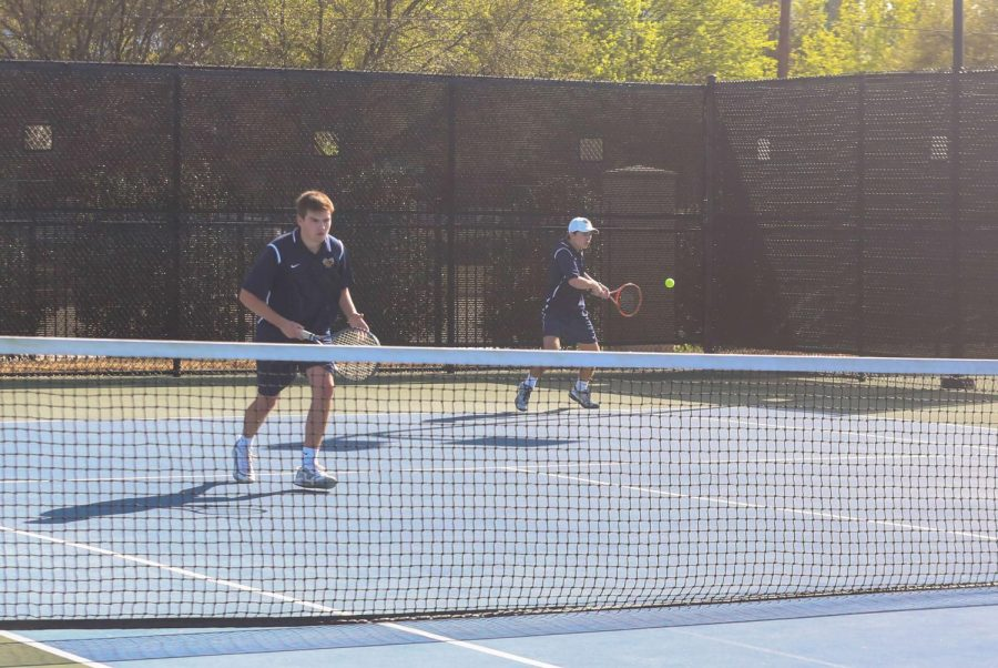 Doubles+team+Cole+Trammel+%2811%29+and+Travis+Pratt+%2812%29+transition+and+hit+the+return+in+their+match+against+John+Paul+II.