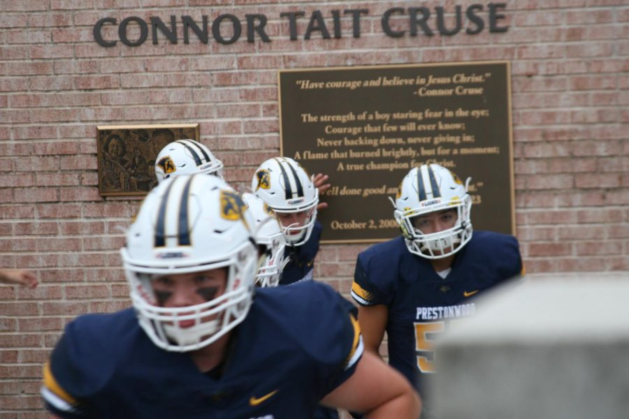 Players thoughtfully give tribute and remember their classmate Connor Cruse before they take the field.