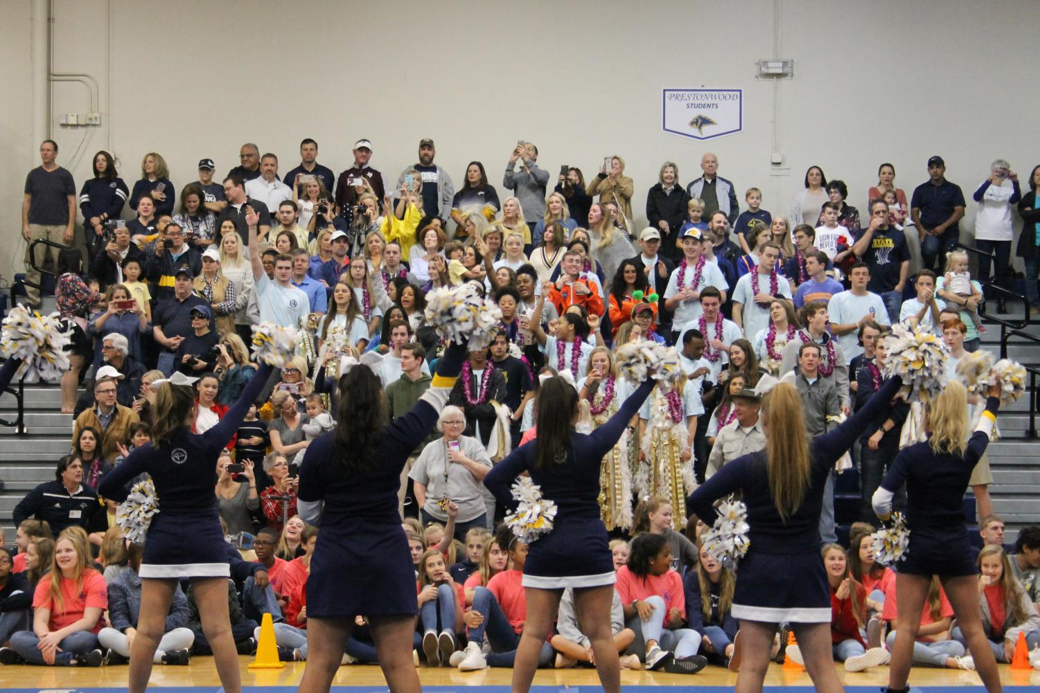 Cheerleaders+lead+the+students+and+their+grandparents+in+a+cheer+at+the+pep+rally.