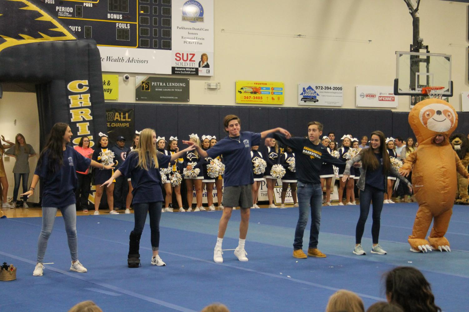 The+Freshman+Homecoming+court+do+the+wave+while+performing+their+dance+at+the+pep+rally.