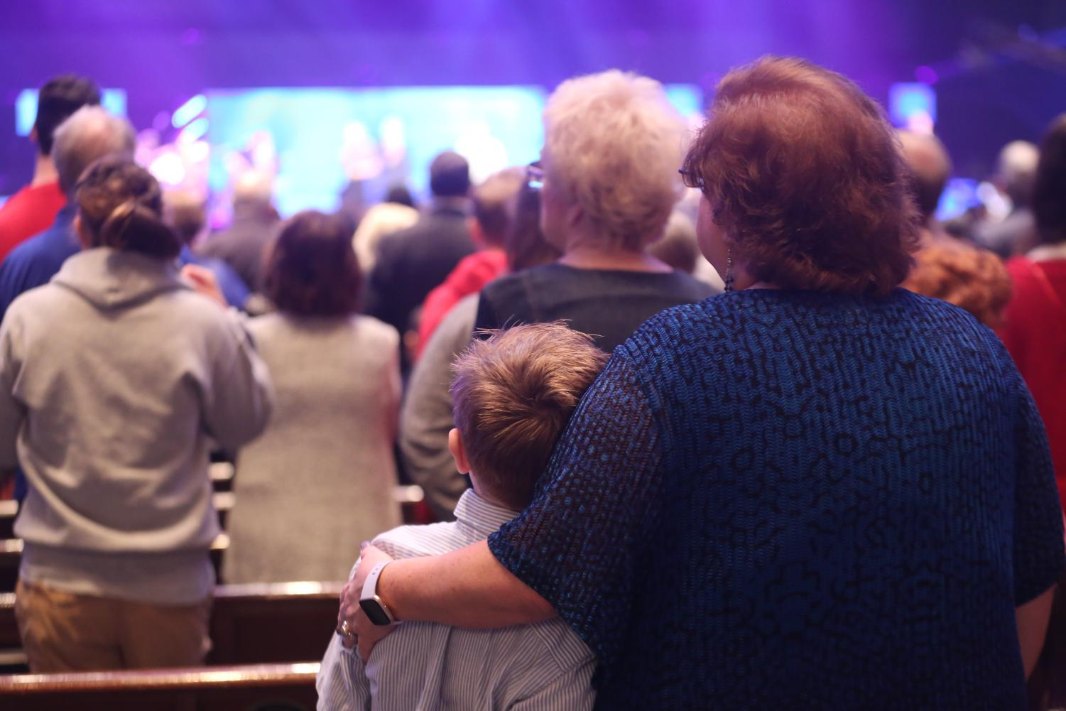 All+School+Worship+on+Grandparent%27s+Day+is+a+time+for+families+to+worship+the+Lord+together.+A+Lower+School+grandson+and+grandmother+snuggle+as+they+sing.+