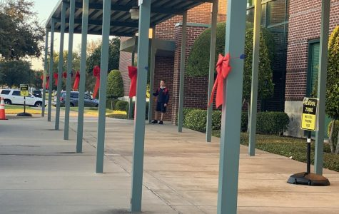 The Lower School celebrates Red Ribbon Week with decorating the outside of the school with red ribbons as parents drive-up through carpool.