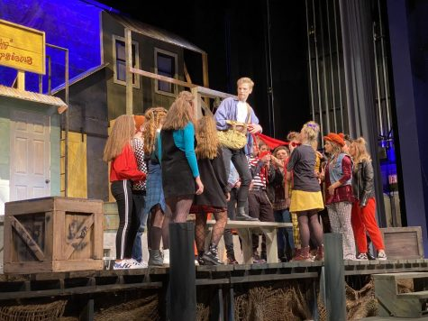 Senior Hunter Hall brings his character to life on stage in Godspell.