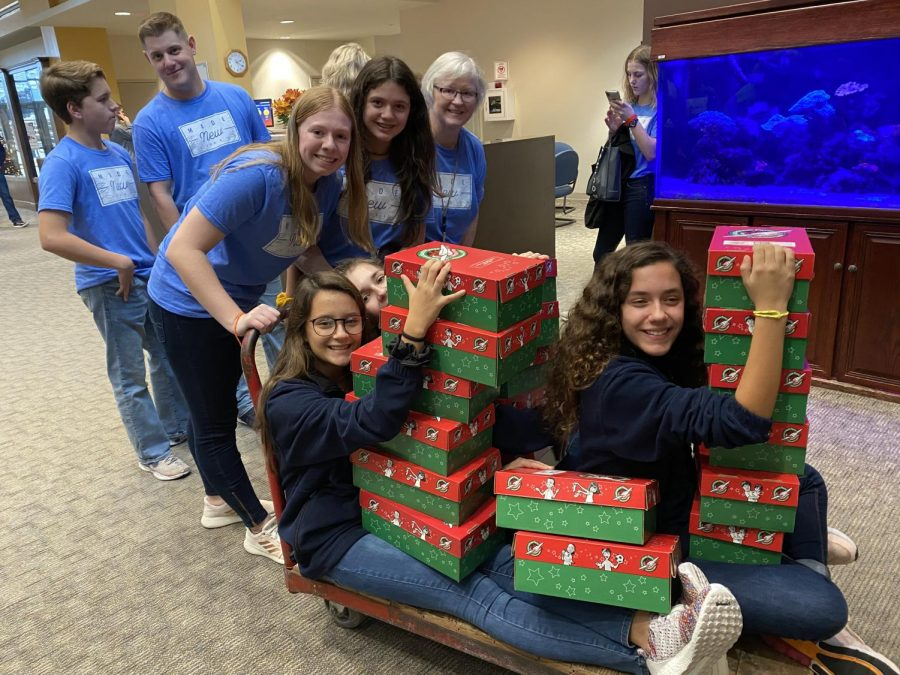 Middle School students serve during PCA's annual Service Project Day by delivering Operation Christmas Child boxes to their drop-off location.