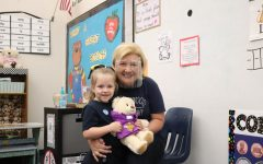 Kindergarten teacher Mrs. Jeanna Soper celebrates a virtual field trip to Build A Bear with her students.