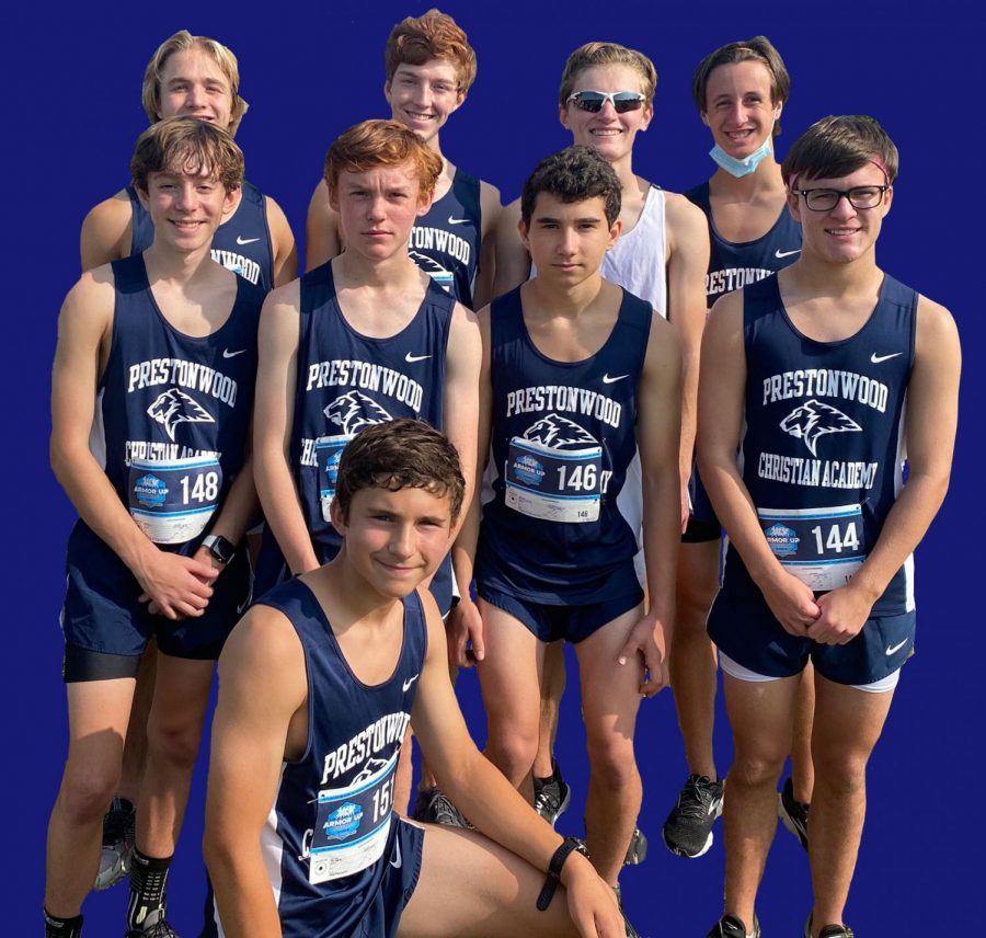 The Varsity Cross Country Team poses for a photo after a meet.