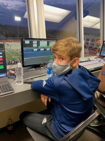 Dalton Chapin (10) runs the instant replay on the score board at the Homecoming football game!