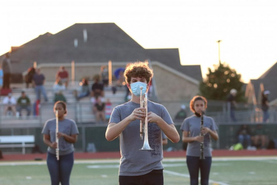 Hayden Taylor (10) gets ready to march to beat of his trumpet.
