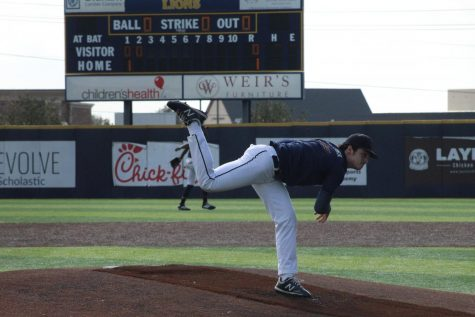 Arben Kolaj (11) begins the game by pitching for the Lions at PCA